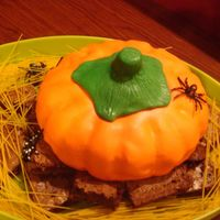 Pumkin Cake This was the first cake I ever did that was covered in fondant. I used a basic bundt cake and shaped the stem. I loved it!