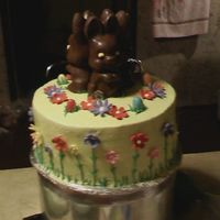 0411092140_0001.jpg Lime green buttercream with gumpaste flowers and store bought chocolate bunnies.