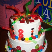Candy Cake Orange/Chocolate cake with Whipped vanilla icing and loaded with gummy lifesavers/ Gummy worrms m&ms reese's peices and other...