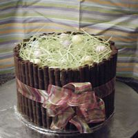 Easter Basket Chocolate Cake w/chocolate buttercreamGrass-candy grass from wal*mart doesn't taste great but looks cuteSide of Basket-Pirouette...