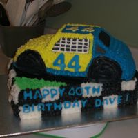 Davies Race Car Birthday Cake  I made this for a friends 40th birthday. All our guys are into racing so, i thought it would be a hit. It is made with 2 sheets (9 x 13...