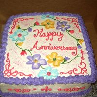 Friend's 18Th Anniversary Cake A cake I did for my friend's 18th anniversary. Chocolate cake with amaretto chocolate and vanilla buttercream icing. First time trying...