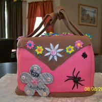 Dress Up Purse Purse cake for the 7th birthday of a little girl who is a little bit girly-girl and a little bit tom-boy hence the bugs). White cake with...