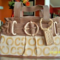 Coach Purse Coach purse cake made for a demonstration party. White cake with lemon buttercream and MMF.P