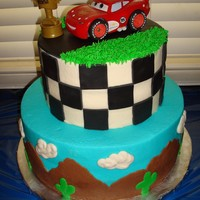 Lightning Mcqueen Birthday I made this cake for my son's 3rd birthday. I didn't have a lot of time, and I'm not proud of sticking a giant plastic toy...