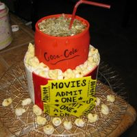 Movie Theme Cake oh man! was this a learning experience or what!! lol...chocolate cake with chocolate buttercream. fondant everything except popcorn; it was...