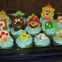 Mario Cupcakes  and here are my cupcakes! first time using fondant all on my own. my friend Qiqi and her little sister joined in on the fun and learning...