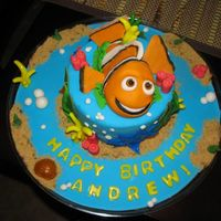 Finding Nemo  chocolate cake, chocolate buttercream. personal cake for 1st birthday! everything is fondant except oceanbottom sand..smashed graham...