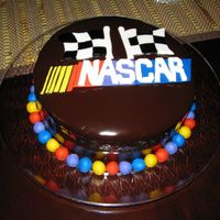Nascar Bday Cake  this is a replica from a pic i was given by the daughter of the birthday man! chocolate cake with dark chocolate buttercream filling,...