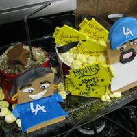 Movie Theater Theme my good friends luis and michelle had their 3rd anvrsry this past weekend and i made a cake with a theme revolving where they met!