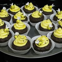 Bees!   chocolate cupcakes with fudge filling, buttercream icing, and fondant bees to top off!