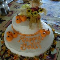 "Happy Fall! Two tiered spice cake with buttercream icing. Pumpkins are made out of fondant and the ""stems"" are a whole clove. The haystack is..."