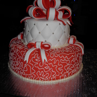 "Red And White Fondant covered cake that was done for Christmas. Bottom tier is 10"" and top is 6""."