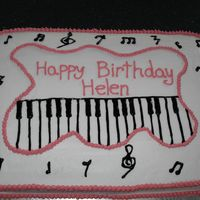 Piano Keys This is a sheet cake (12x18) with no filling and buttercream icing. The notes are piped in black gel and the pink icing is buttercream.