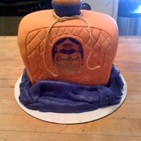 "Crown Royal Birthday Cake Crown Royal Birthday Cake. Used 10"" square pan, cut layers in half and stacked then carved. Covered in Chocopan."