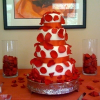 "4 Tier Round White, Deep Orange And Red Rose Wedding Cake My first wedding cake!! (4) tier round 10"", 8"", 6"" & 4"". Covered in wedding white fondant with fresh red roses..."
