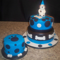 "Blue And Brown Doggie Themed 1St Birthday Main cake 10"" and 8"" rounds covered and decorated in fondant. Smash cake 6"" covered and decorated in fondant. When I..."