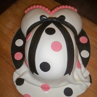 Mommy Baby Bump Cake Mommy baby bump cake. Used wilton mini ball pans for the breast carved down just a little bit and wilton egg pan for the belly. Put an 8&...