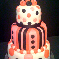 "Pink, White And Black Polka Dot 4Th Birthday Cake 3 tier- 8""/6""/4"". Covered and decorated in fondant."
