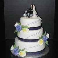 Motor Cycle Wedding Cake Motorcycle wedding cake, hand painted tracks to the top of the cake, flowers are gumpaste