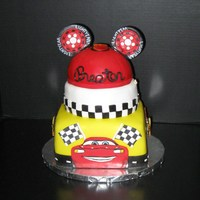Mickey Mouse Cars Cake Mickey mouse Cars cake, 8 inch square, 7 inch round and 6 inch half ball cake.ears, lighting and lightning Mcqueen are made out of gum...