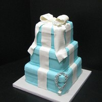 Tiffany Cake Tiffany cake, 6-8-10 inch square cakes, fondant bow, bracelet is made out of gum paste, tooth hanging for bracelet is also gum paste, the...