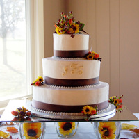 Fall Wedding Cake Simple wedding cake, buttercream iced with ribbon. Monogram initials piped on and dusted with gold luster dust. I was left a vase of fresh...