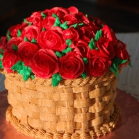 Basketful Of Roses I made this Valentine's cake for my aunt. It is made using the giant cupcake pan. It's all buttercream, including roses, leaves,...