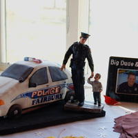 Police Car Groom's Cake The groom is a police officer for Fairbury and his wife to be wanted to surprise him with this cake. The license plate is personalized with...