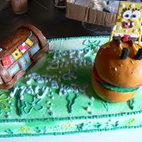 Spongebob / Krusty Krabs Made for a friend. Spongebob chocolate sucker with fondant trimings,white cake buttercream frosting,can sprayed wilton, Krabby patty and...