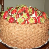 Basket Of Strawberries This is the Birthday Cake I made for my sisters 35th birthday. Yellow cake filled and frosted with choc. BC. Topped with choc. and white...