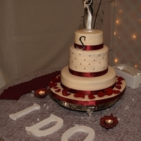 "November Wedding This is a cake I made for a November wedding. 12"", 8"" and 6"" . Bottom and top tiers are white cake, middle tier is red..."