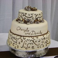 Belgium Chocolates On Fondant This is a wedding cake that I made for a friend of mine. MFF painted with brown Wilton's gel color thinned with clear vanilla,...