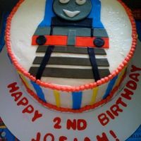 Thomas The Train 8 inch buttercream cake with fondant decorations. Cake is chocolate. It was really fun to make!