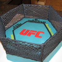 Ufc Cage Please pardon the fact that this cake is actually a hexagon instead of an octagon! The cage was made using black colorflow frosting, the...