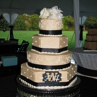 Creamy Dreamy This cake is a combination of alternating round and hexagon layers. The couple's monogram is piped on a colorflow plaque. The layers...