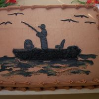 Break Of Dawn Solid, black silhouettes make this fishing themed groom's cake unique, yet elegant.