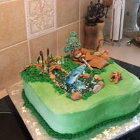 Fishing Birthday Cake made for grandson who loves fishing. Cinnamon roll cake with buttercream. All decorations done in gumpaste and fondant.