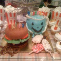 Foodies Cake This was a combination birthday cake for 3 people. Mr. Koolaide, the hamburger and popsicles are all cake. The pretzels were made of rolled...