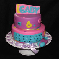 I Gaby Cake   This cake was made for a little girl who lose i-Carly. 8' & 10' cakes covered with MMF. The mouse was RKT covered with MMF.