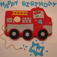 Fire Truck This cake was made to match the invitation. It was a double layer 12x18 sheet cake that was carved. All decorations are made of mmf. Thanks...