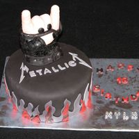 Rock On Metallica This cake was made for a boy who was turning 18 and loves Metallica. The hand was molded from RKT then covered with MMF. Had some...