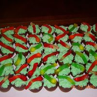 "Spring Is Here!! Little mini chocolate cupcakes with BC ""grass"" and gummy worms... My kids eat them up like nothing... LOL"