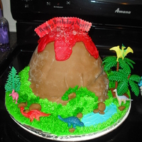 Volcano Cake This was a very simple volcano cake done for a friend on a budget. I used the wilton doll cake mold and one 8 or 9 inch round filled and...