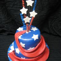 4Th Of July Cake This is a two tiered cake covered in blue fondant with white stars. I made the top stars and curly q's from gumpaste and attached them...