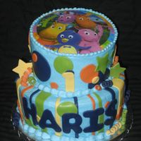 Backyardigans 1St Birthday Cake This cake is iced in buttercream and decorated with fondant decorations. The image on the top tier is an icing image order from the...