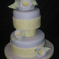 Purple & Yellow Floral Cake This cake is covered in pale purple fondant. I used a textured rolling pin for the design on the yellow fondant that is wrapped around each...