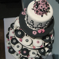 Wedding Cupcake Tower Black and white cupcake tower for a wedding cocktail party. Theme echos the couple's wedding invitations, which were a fun, modern...