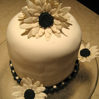 Black And White Daisy Cake Made this for New Years Eve dinner celebration. Gum paste flowers. Thanks for looking!