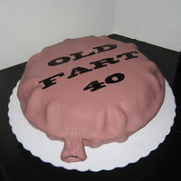 "Whoopie Cushion Cake A big thanks to Mooj for the funny, funny idea. I made this for a 40th birthday party. Used two 10"" rounds carved into a pillow. Used..."